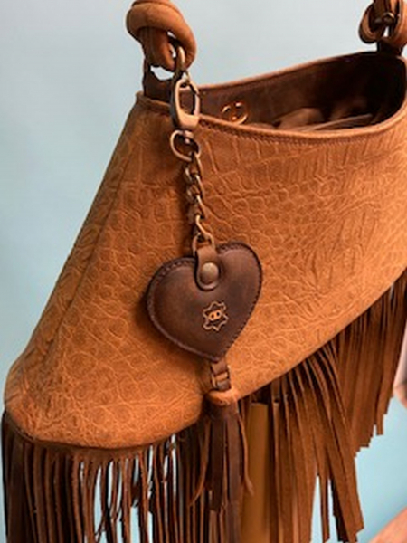 Leather case with fringes and soft touch
